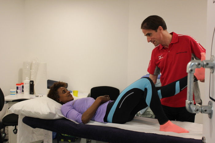 Noel assessing a client with a running injury